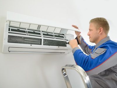 Engineer fitting an aircon unit